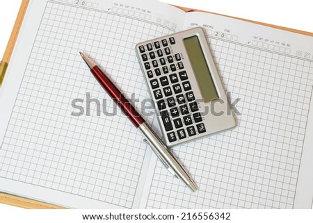 Notepad open with a pen and calculator - stock photo