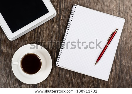 notepad, pen, coffee and tablet, workplace businessman - stock photo