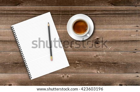 Notepad with cup of coffee on wooden table