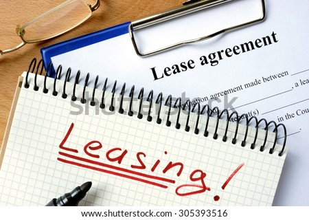 Notepad with leasing and lease agreement form. - stock photo