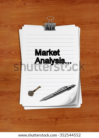 "Notepad with paper clip isolated on a wooden surface. A pen and an old key are on the paper. ""Market Analysis"" is written on the notepad as a reminder."