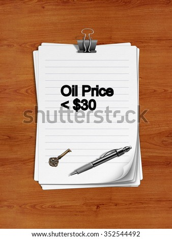 "Notepad with paper clip isolated on a wooden surface. A pen and an old key are on the paper.""Oil Price < $30"" is written on the notepad as a reminder."