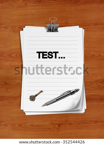 "Notepad with paper clip isolated on a wooden surface. A pen and an old key are on the paper. ""Test"" is written on the notepad as a reminder."