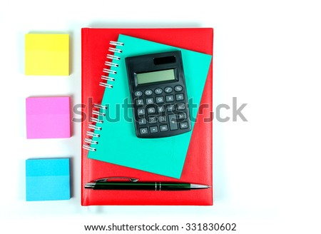 Notepads, calculator a pen and post it notes on white background - stock photo