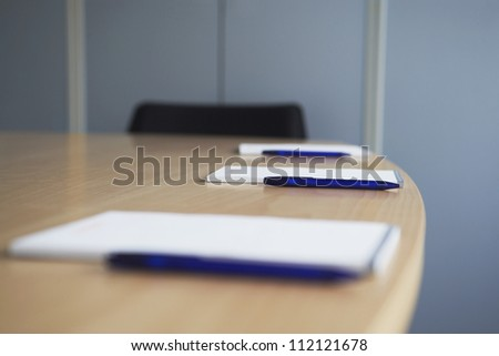 Notepads with pen on wooden table