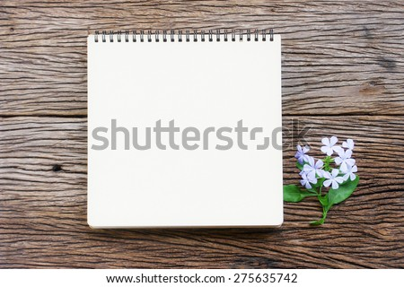 Notes and flower on wood table