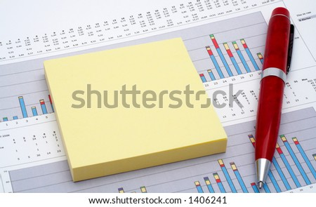 Notes and pen on earnings chart background