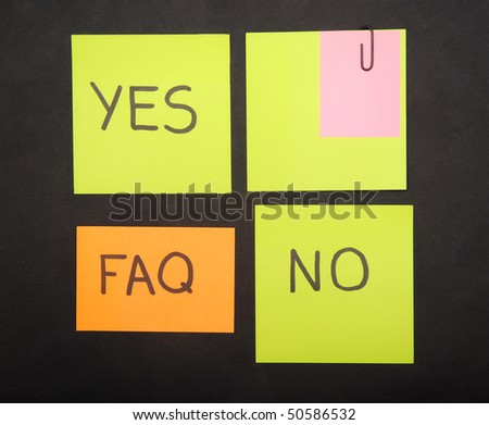 notes with faq isolated on black - stock photo