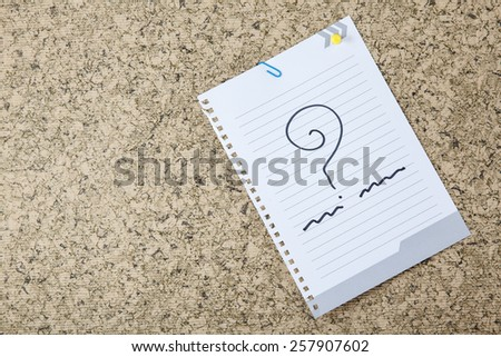 notes with question marks. - stock photo
