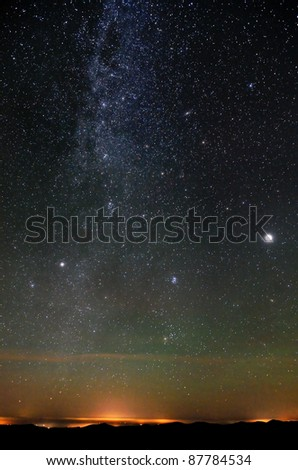 Nothern part of Milky Way over city lights - stock photo