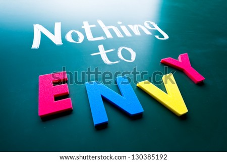 Nothing to envy, conceptual words on blackboard - stock photo