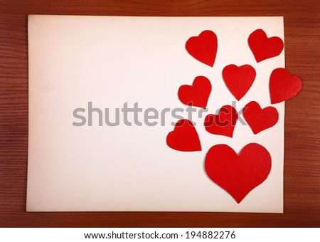 Notice Board with Heart Shapes on Wooden Background