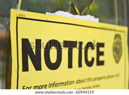 Notice sign posted on a condemned house door - stock photo
