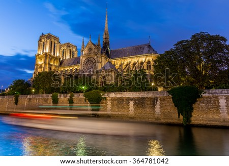 Notre Dame at night in Paris, France - stock photo