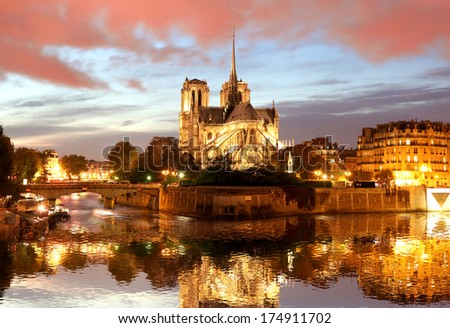 Notre Dame cathedral against sunset in  Paris, France - stock photo