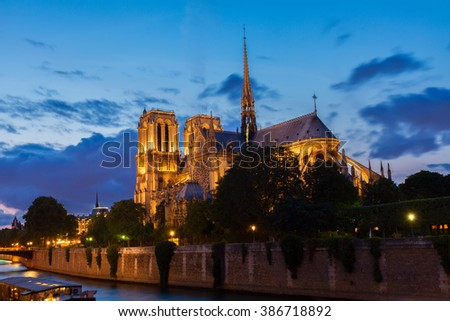 Notre Dame  cathedral illuminated  at blue night, Paris, France - stock photo
