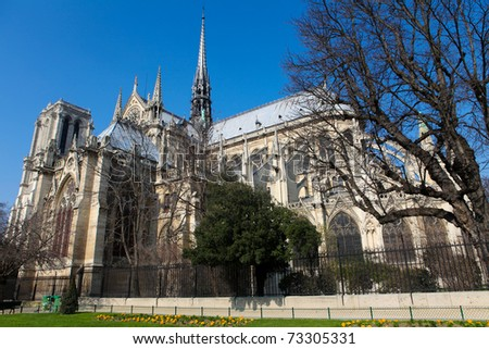 Notre Dame cathedral in the center of Paris, France, on a sunny day - stock photo
