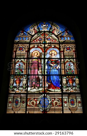 Notre Dame church in Versailles, France. Beautiful stained glass art depicting Archangel Raphael and Saint Virgin Mary.