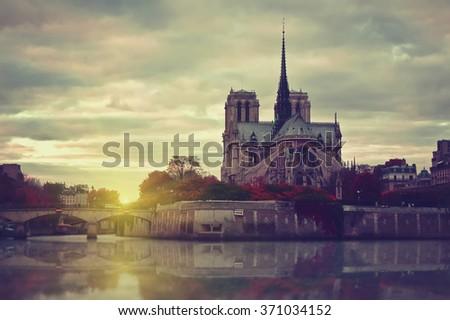 Notre Dame de Paris at sunset. Vintage style picture. Travel background - stock photo
