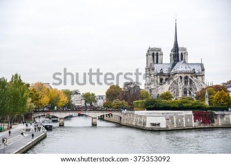 Notre Dame de Paris Cathedral and Seine River in autumn of Paris, France - stock photo
