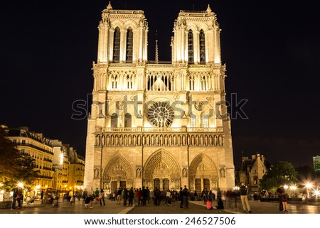 Notre Dame de Paris cathedral at night is one of the most visited places in Paris - stock photo