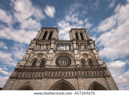 Notre Dame de Paris. France. Ancient catholic cathedral on the quay of a river Seine. Famous touristic architecture landmark in summer