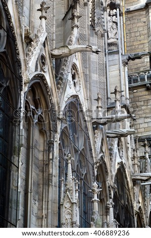 Notre-Dame de Paris. View of northern facade and gothic gargoyles in the foreground