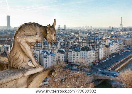 Notre Dame of Paris: Chimera overlooking the skyline of Paris at a sunset