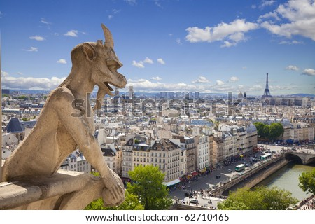 Notre Dame of Paris: Famous Chimera (demon) overlooking the Eiffel Tower at a summer day - stock photo