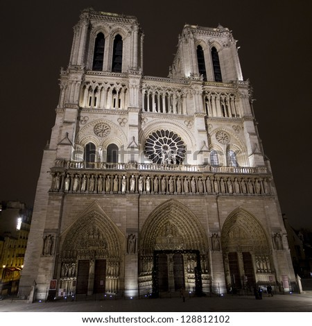 notre dame, paris, by night - stock photo