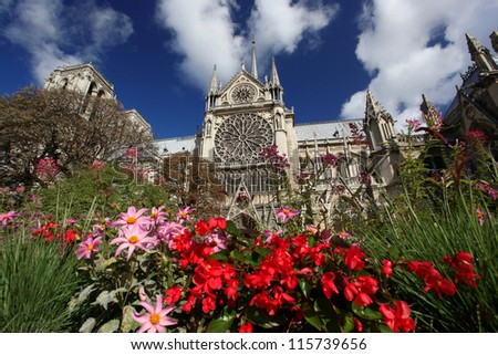 Notre Dame with flowers in Paris, France - stock photo