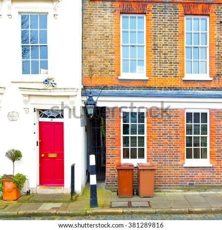 notting hill in london england old suburban and antique      wall door  - stock photo
