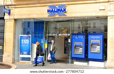 NOTTINGHAM, UK - APRIL 1, 2015: People exit the Halifax bank in Nottingham, Nottinghamshire, England. Halifax is a banking chain in the United Kingdom and a division of Bank of Scotland