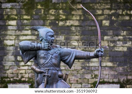 NOTTINGHAM, UK - DECEMBER 04: Statue of Robin Hood outside Nottingham castle. The statue, created by James Woodford, was unveiled in 1952. December 04, 2015 in Nottingham. - stock photo