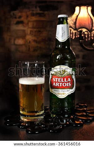 NOTTINGHAM, UK - JANUARY 12, 2016: Bottle of Stella Artois 4.8% ABV  lager beer. Stella was introduced in 1926 in Belgium. - stock photo