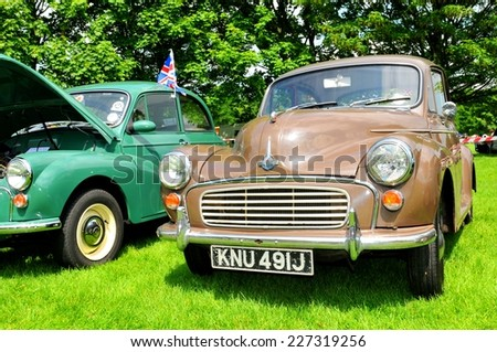 NOTTINGHAM, UK - JUNE 1, 2014: Frontal view of a brown Morris vintage care for sale in Nottingham, England. - stock photo