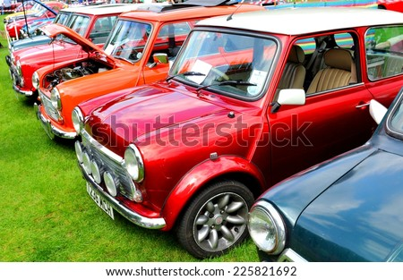 NOTTINGHAM, UK - JUNE 1, 2014: Row of Mini Cooper vintage car for sale in Nottingham, England. - stock photo