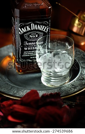 NOTTINGHAM, UNITED KINGDOM - APRIL 30, 2015: Jack Daniel's whiskey bottle and glass. Jack Daniel's is a brand of sour mash Tennessee whiskey and the highest selling American whiskey in the world. - stock photo