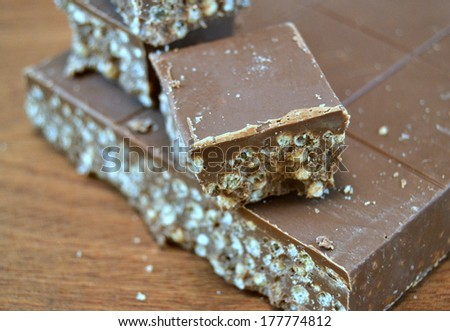 Nougat chocolate on wooden table - stock photo
