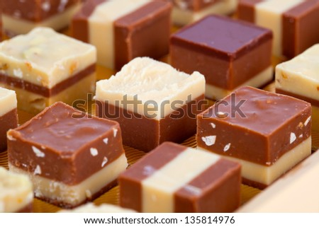 Nougat praline, delicious mix of nougat and almond creme - stock photo