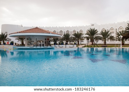 Nov 24, 2013, Liwa, UAE: Liwa Hotel, swimming pool and date palm park. This a well known desert oasis hotel.