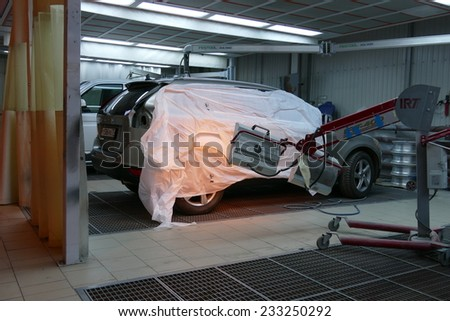 NOV 23, 2014. Local heater lamp for paint drying in Ness visit car service, Moscow,  RUSSIA - stock photo