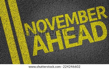 November Ahead written on the road - stock photo