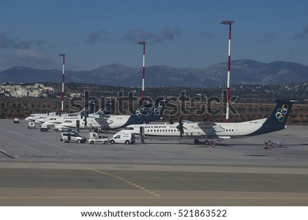 November 10, 2016. Athens International Airport, Greece. All the turboprop fleet of Olympic Air in the tarmac of the airport. ATR 42 600, DHC Dash 8 102A & 402Q. Olympic is owned by Aegean Airlines