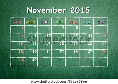 November 2015 calendar: Monthly time table schedule with freehand doodle white and pastel color chalk drawing on green blackboard background: Colorful blank timetable planner for school and business