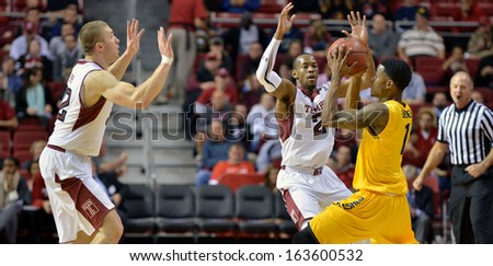NOVEMBER 11 - PHILADELPHIA: Temple Owls guard Will Cummings (2) and Dalton Pepper trap a Flash player during the NCAA basketball game against Kent State November 11, 2013 in Philadelphia  - stock photo