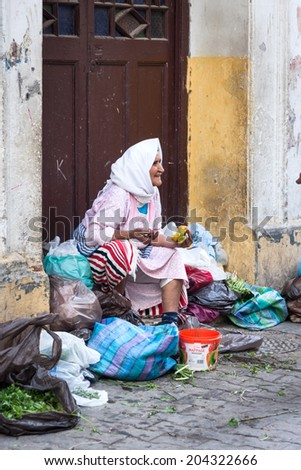 NOVEMBER 3.2013-TANGIER, MOROCCO: In the photo we see a woman selling their fruits and vegetables in the old medina of Tangier - stock photo