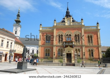 NOVI SAD, SERBIA - AUGUST 02: statue J. J. Zmaj and neo-classical architecture of Vladicin Court Palace of Bishop in Novi Sad. Shot in 2014  - stock photo