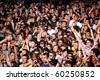 NOVI SAD, SERBIA - CIRCA JULY 2010: Audience in front of the Dance Stage at the Best European Music Festival - EXIT 2010, circa July 2010 at the Petrovaradin Fortress in Novi Sad, Serbia. - stock photo