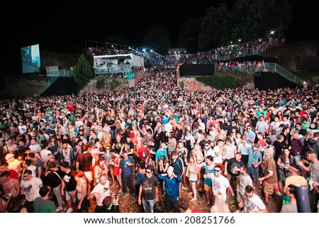 NOVI SAD, SERBIA - JULY 12: Audience infront of the Dance Arena at EXIT 2014 Music Festival, during Tiga and DJ Hell performance on July 12, 2014 in the Petrovaradin Fortress in Novi Sad.  - stock photo